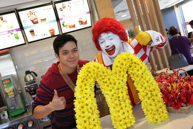 McDonald's celebrity influencer Elmo Magalona poses with McDonald's Chief Happiness Officer Ronald McDonald during the store opening.